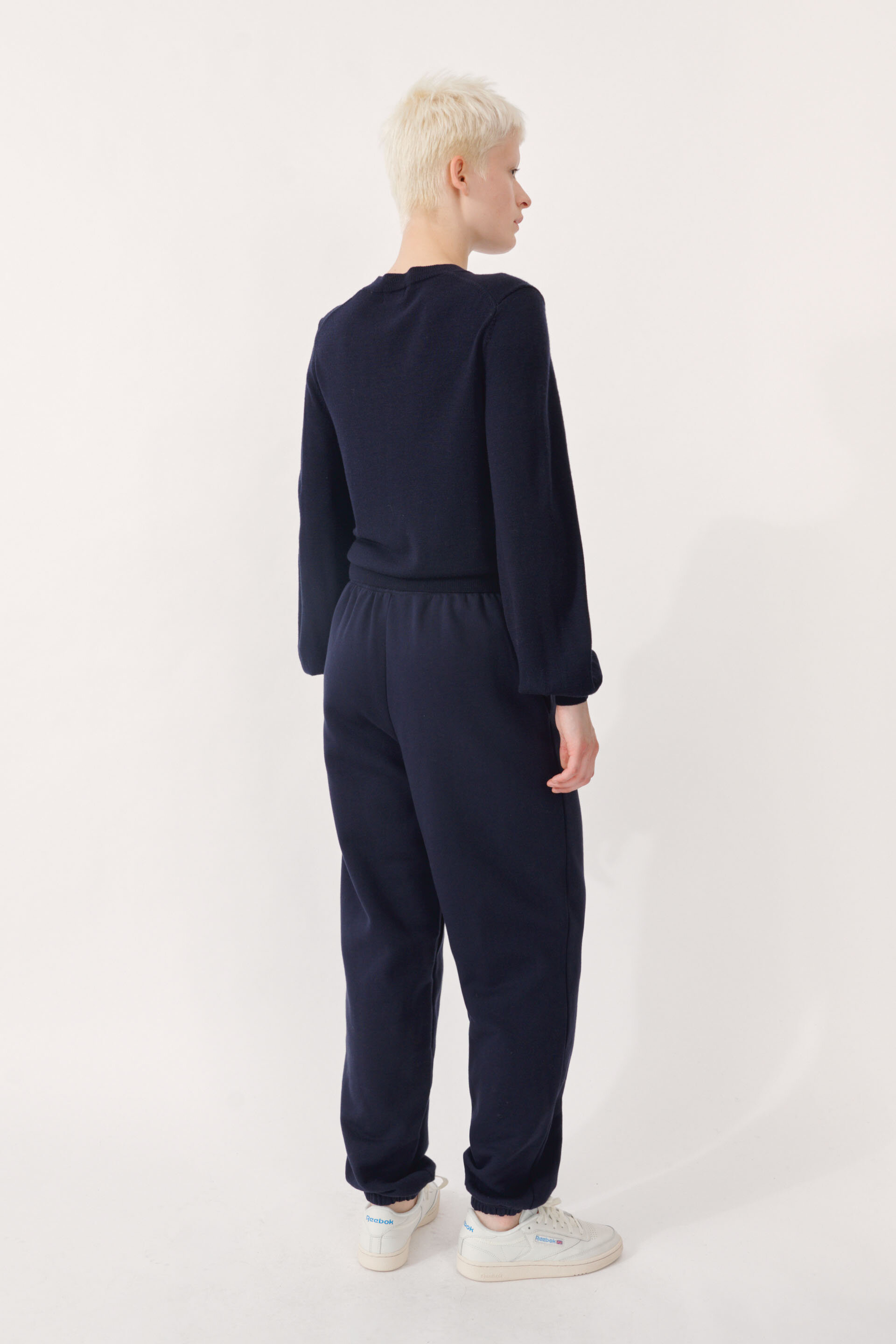 """Calynn Cardigan Night Sky A thin-knit, fitted cardigan with button closures down the front and the """"UND"""" logo embroidered on the side - detail image"""